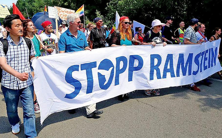 Protesters march outside Ramstein Air Base, Germany, in 2018. Peace activists are expected to demonstrate again this year, beginning July 4, 2021.