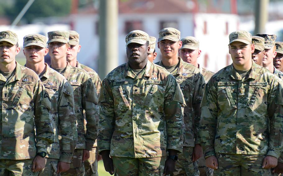 Soldiers stand at attention during a ceremony marking their graduation from the Army's Basic Airborne Course at Fort Benning, Ga. on Friday, May 21, 2021. It marked the first airborne school graduation open to family and loved ones since the beginning of the coronavirus pandemic.