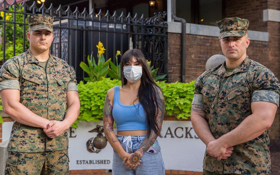 Virginia Waller-Torres stands with Cpl. Mitchell Wojtowicz, left, and Cpl. Jared Tosner, at Marine Barracks Washington, Sept. 20, 2021. Waller-Torres thanked them for helping push her car out of floodwaters near Arlington Cemetery during a downpour on Sept. 16.