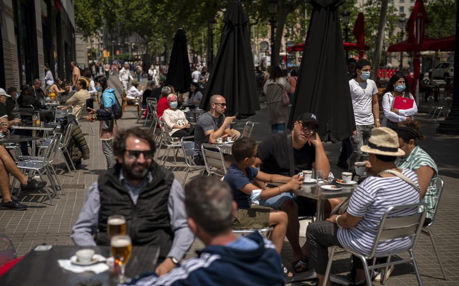Customers sit in a terrace bar in downtown Barcelona, Spain on May 28, 2021..