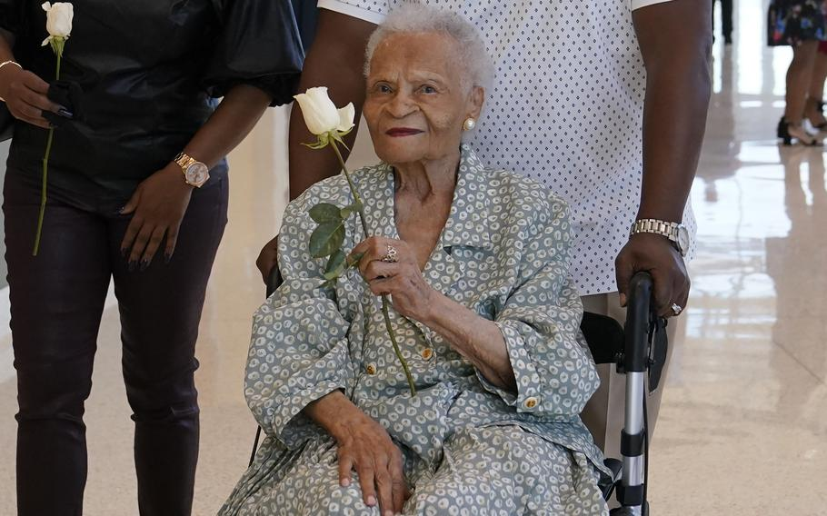 Viola Fletcher, the oldest living survivor of the Tulsa race massacre, holds a rose she received as she arrives for a luncheon honoring survivors on May 29, 2021, in Tulsa, Okla. According to reports on Saturday, Sept. 4, Fletcher and her brother Hughes Van Ellis were invited to Ghana where they were greeted by royalty.