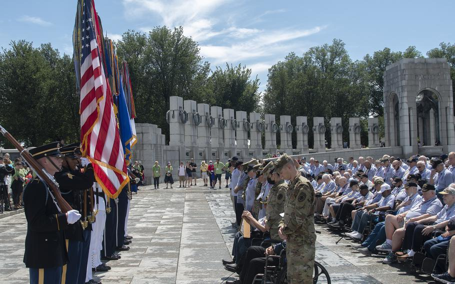 A moment of silence is observed at the World War II Memorial in Washington, D.C., on Wednesday, Aug. 18, 2021, during an Honor Flight ceremony that paid tribute to veterans from World War II, the Korean War and the Vietnam War.