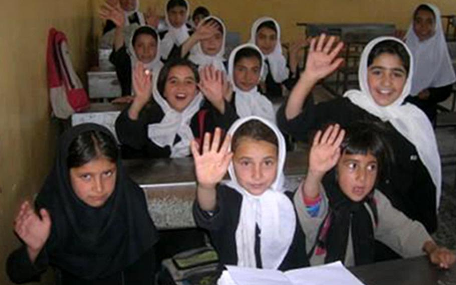 Students thank U.S. troops for the school built for them in Shadi Jam, a town in the Afghan province of Herat, in a photo taken during Sean Gustafson's deployment there from 2006-2007. Gustafson, a U.S. Army major at the time, said the Taliban capture of Herat on Aug. 12, 2021 surprised him.