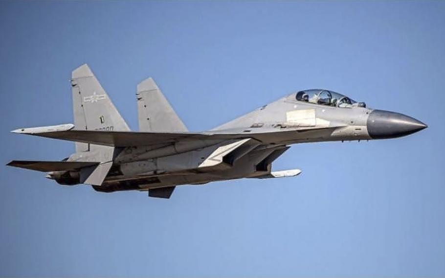 A Chinese PLA J-16 fighter jet flies in an undisclosed location.
