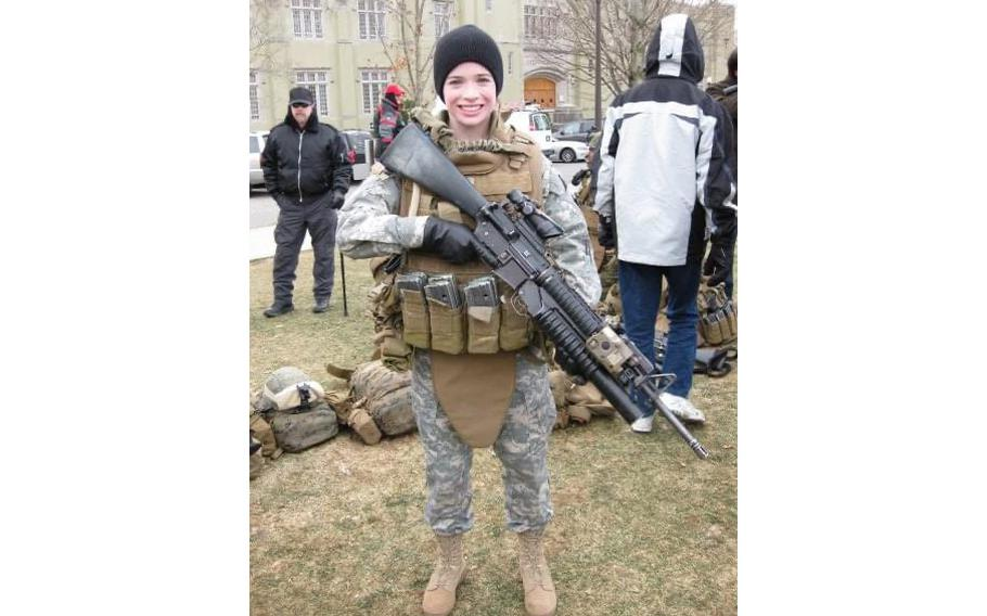 Elizabeth Dobbins Moskowitz displays an unloaded weapon when she was a 20-year-old sophomore at Virginia Military Institute.