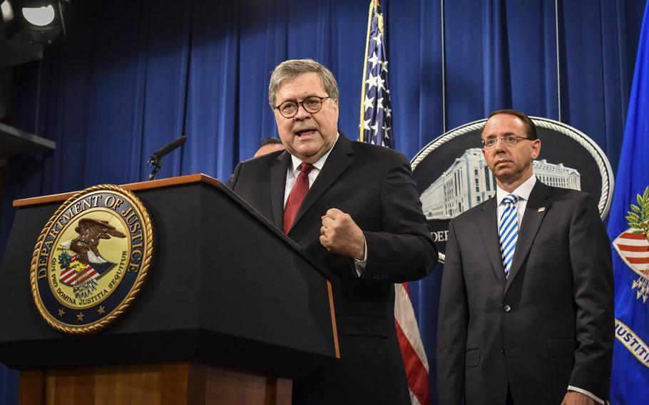 Attorney General William P. Barr, left, speaks during a news conference hours before releasing a redacted version of the Mueller report on April 18, 2019. Deputy Attorney General Rod J. Rosenstein is behind him at right.