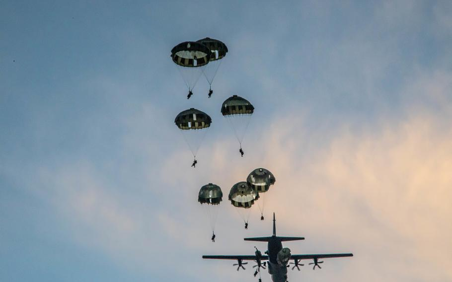 Soldiers from 1st Special Forces Group and members of the Japan Ground Self-Defense Forces Group parachute during a joint airborne operation on Andersen Air Force Base, Guam, July 30, 2021, during Exercise Forager 21.