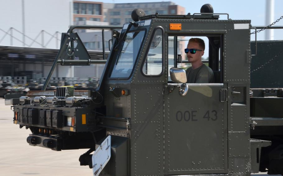 Airman 1st Class Ryan Joy drives a Tunner 60K aircraft cargo loader during the 721st Aerial Port Squadron Multi-Capable Airmen Rodeo at Ramstein Air Base, July 23, 2021.