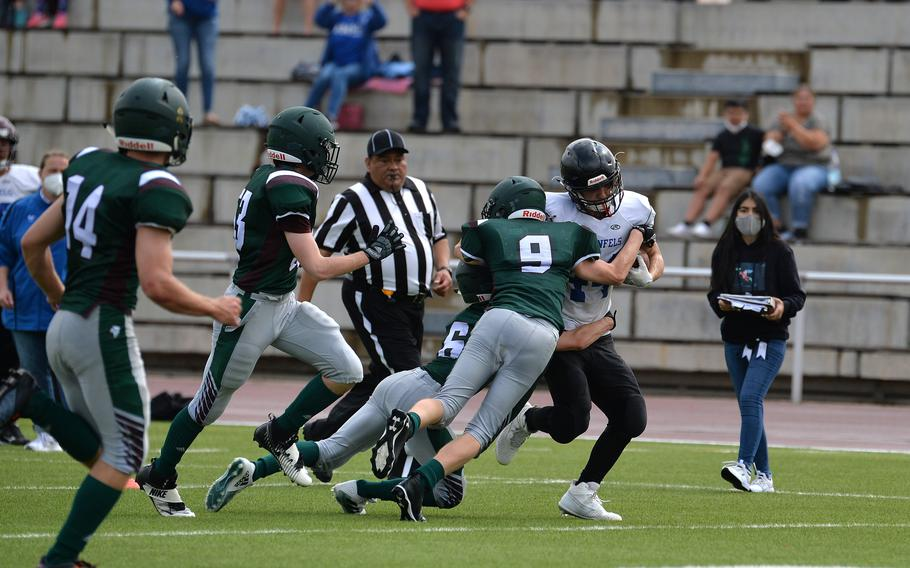 A pride of AFNORTH Lions gang up on Jaiden Workman of Hohenfels in the Tigers' 76-28 loss to the Lions in a game played at Kaiserslautern High School, Sept. 11, 2021. AFNORTH made one of the relatively few international trips on the fall schedule, venturing from its Netherlands base to Germany, where it met the Tigers halfway for six-man Division III football action on a neutral field.