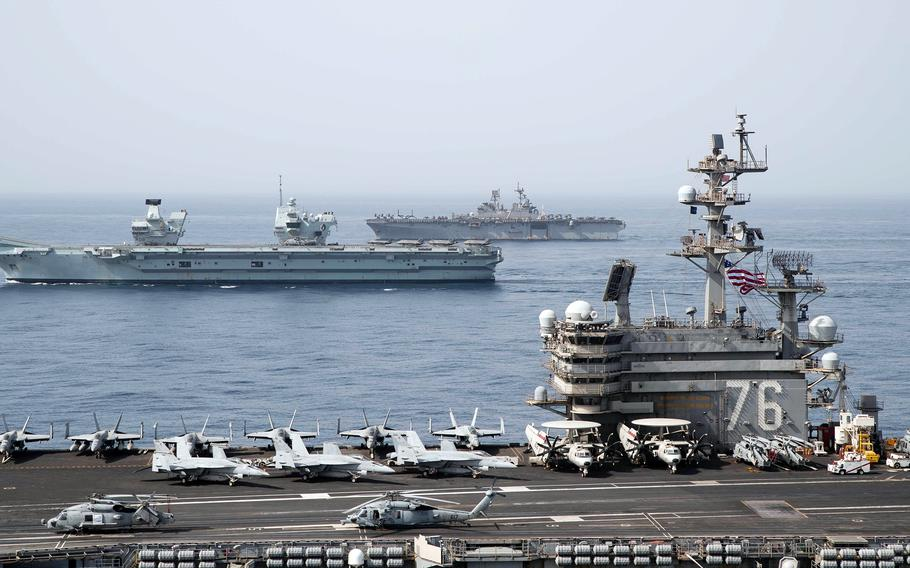 The aircraft carrier USS Ronald Reagan, foreground, the Royal Navy carrier HMS Queen Elizabeth, center, and the amphibious assault ship USS Iwo Jima steam through the Gulf of Aden, Monday, July 12, 2021.