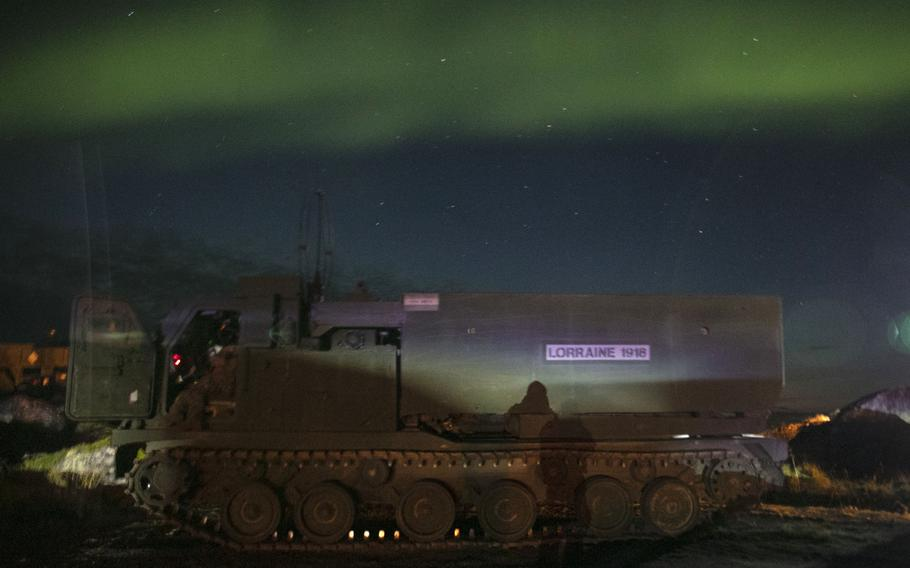 The northern lights shined above the soldiers from the 1st Battalion, 6th Field Artillery Regiment, 41st Field Artillery Brigade after they successfully fired six M31 rockets during the Thunder Cloud live-fire exercise in Andoya, Norway, on Sept. 15, 2021.