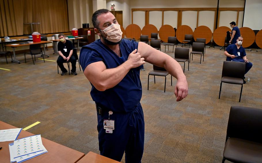 Brad Butcher, a Pittsburgh physician, prepares to get his second coronavirus vaccine in January.