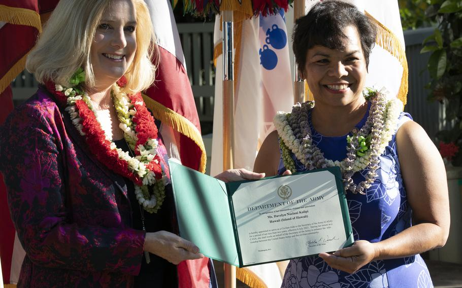 U.S. Secretary of the Army Christine Wormuth presents newly appointed Civilian Aide to the Secretary of the Army (CASA), Mrs. Noelani Kalipi of the island of Hawaii, the oath of office certificate on Fort Shafter, Hawaii, Aug. 9, 2021. CASAs are business and community leaders appointed by the Secretary of the Army to advise and support Army leaders across the country.
