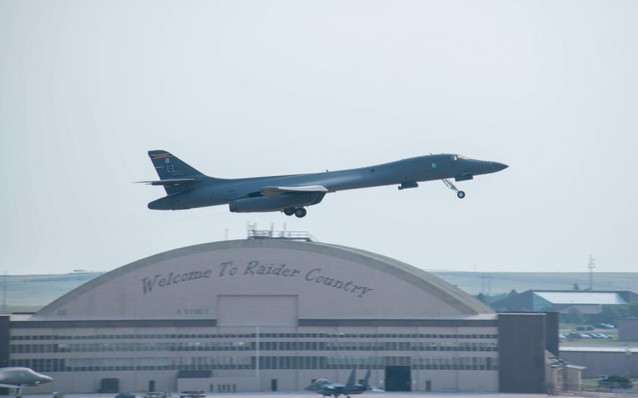 A 34th Bomb Squadron B-1B Lancer gains altitude at Ellsworth Air Force Base, S.D., July 20, 2021. The B-1 was one of the first aircraft to take off as part of exercise Combat Raider 21, which is designed to train aircrew in a wide range of operations against modern threats.