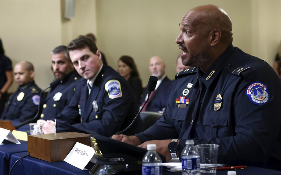Washington Metropolitan Police Department officer Daniel Hodges, second from right, listens as U.S. Capitol Police Sgt. Harry Dunn testifies during the House select committee hearing on the Jan. 6 attack on Capitol Hill in Washington, Tuesday, July 27, 2021. U.S. Capitol Police Sgt. Aquilino Gonell, left, and Washington Metropolitan Police Department officer Michael Fanone, second from left, listen.
