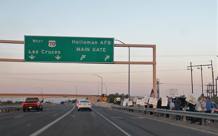 People outside Holloman Air Force Base on Monday, Sept. 13, 2021, protest military vaccine mandates.