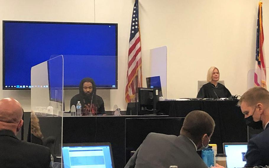 Macquise Lewis testifies during the trial of Fort Stewart soldier Tevin Biles-Thomas, who is charged with murder, manslaughter and other charges in a New Year's Eve 2018 shooting that left three people dead.
