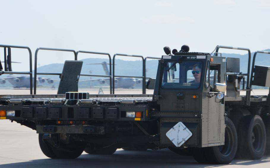 """Airman 1st Class Ryan Joy drives a Tunner 60K aircraft cargo loader around a course at Ramstein Air Base on July 23, during the 721st Aerial Port Squadron Multi-Capable Airmen Rodeo. Joy, a ramp services agent with the 721st APS, has been driving loaders for two years, but """"not as pedal-to-the-metal"""" as during the rodeo, he said."""