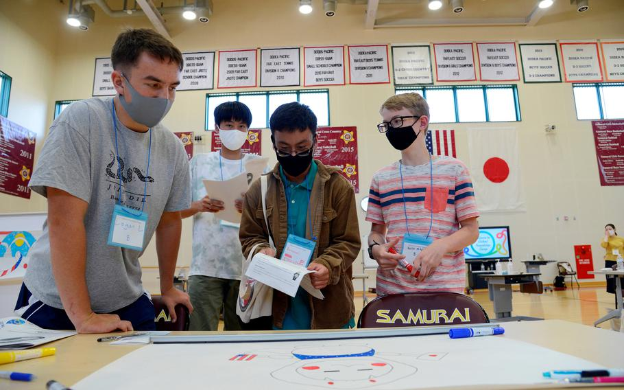 American and Japanese students work on a project during a cultural-exchange camp at Matthew C. Perry High School on Marine Corps Air Station Iwakuni, Japan, Sunday, Oct. 3, 2021.