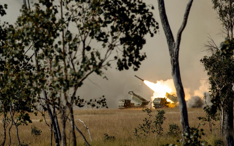 U.S. Marines and soldiers fire high mobility artillery rocket systems during Exercise Talisman Saber in the Shoalwater Bay training area in Queensland, Australia on July 18, 2021.