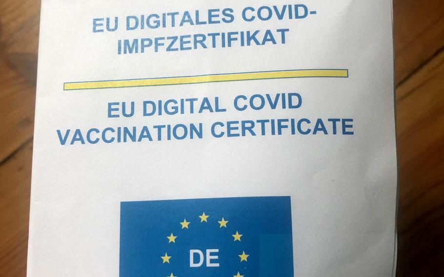 The print-out of a the EU digital COVID-19 vaccination certificate delivered to a U.S. citizen in Kaiserslautern, Germany, June 22, 2021, can be folded in four or uploaded to the Corona-Warn app or the CovPass app.