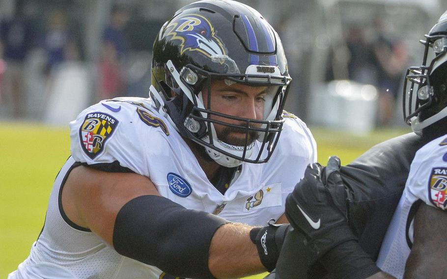 Baltimore Ravens offensive tackle Alejandro Villanueva, left, practices blocking during a drill in August, 2021.