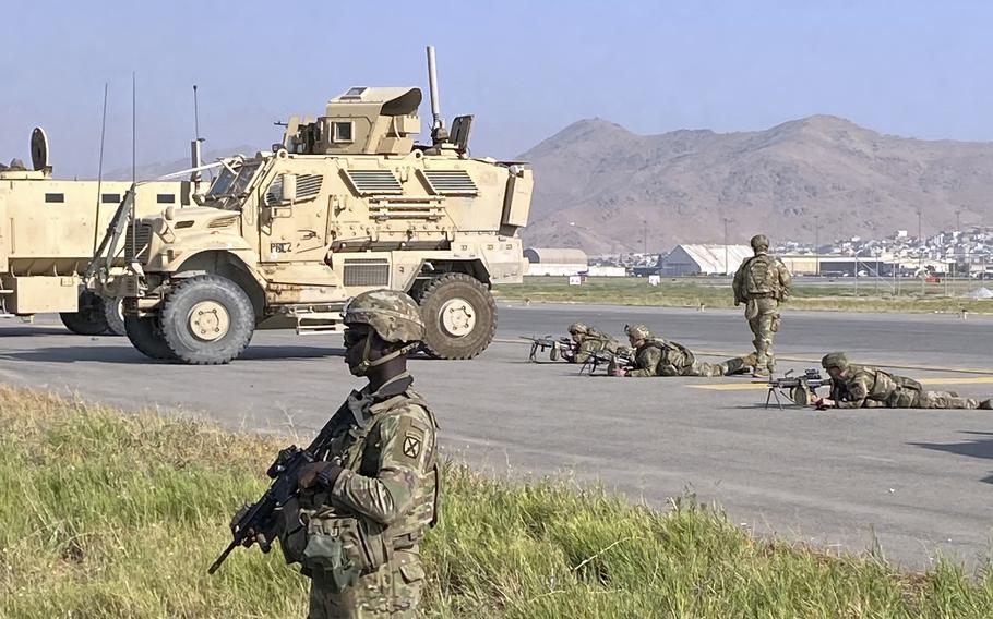 U.S troops stand guard along a perimeter at the international airport in Kabul, Afghanistan, Monday, Aug. 16, 2021.