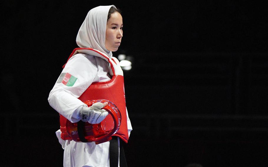 Afghan Taekwondo athlete Zakia Khudadadi, 22, enters the octagon to compete during the Tokyo Paralympics in Chiba prefecture, Japan, Thursday, Sept. 2, 2021.
