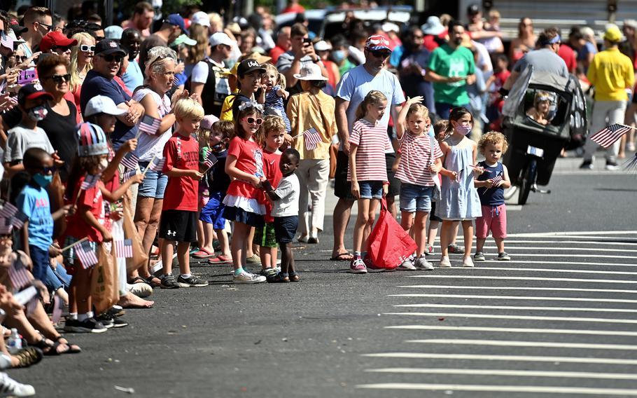 Spectators enjoy the Barracks Row Parade celebrating Independence Day in Washington, D.C., on July 4, 2021.