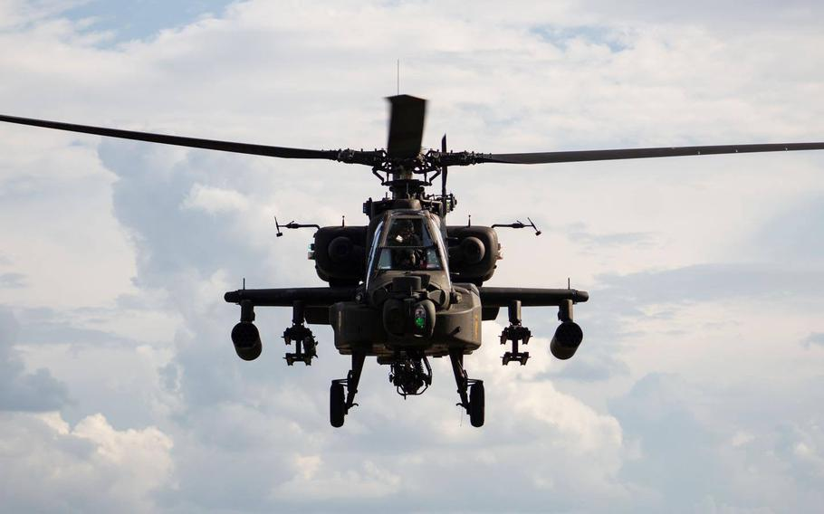 An AH-64 Apache attack helicopter with the 1st Cavalry Division Combat Aviation Brigade conducts training in September at Fort Hood, Texas. About 2,000 troopers from the brigade will deploy to Europe this fall for a nine-month training rotation with Operation Atlantic Resolve.