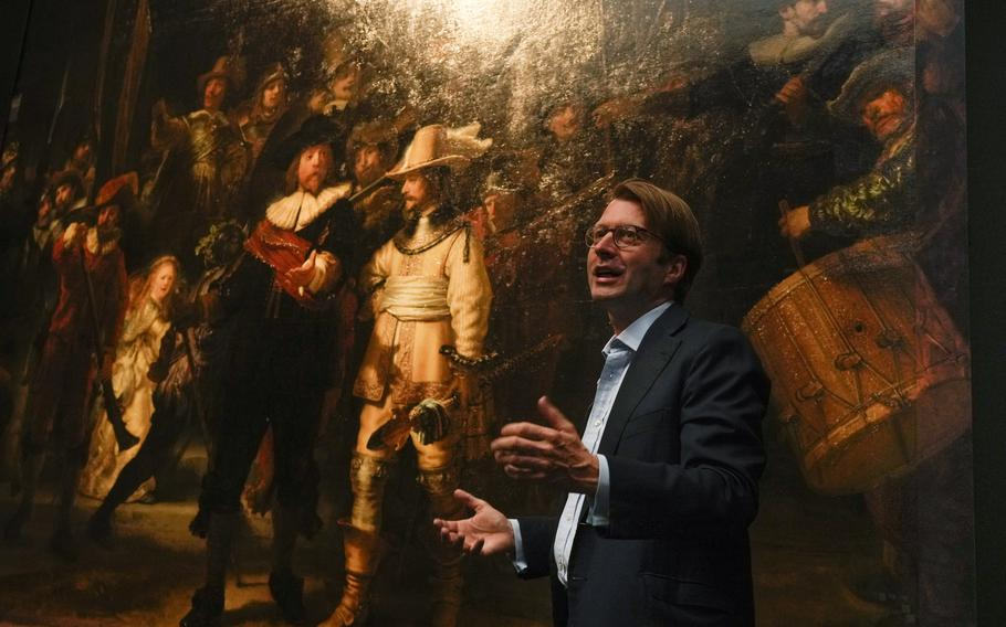 The added part of the painting is seen right as Rijksmuseum director Taco Dibbits explains how Rembrandt's biggest painting the Night Watch just got bigger with the help of artificial intelligence in Amsterdam, Netherlands, Wednesday, June 23, 2021. The Dutch national museum and art gallery reveals findings from a long-term project to examine in minute detail Rembrandt van Rijn's masterpiece the Night Watch.
