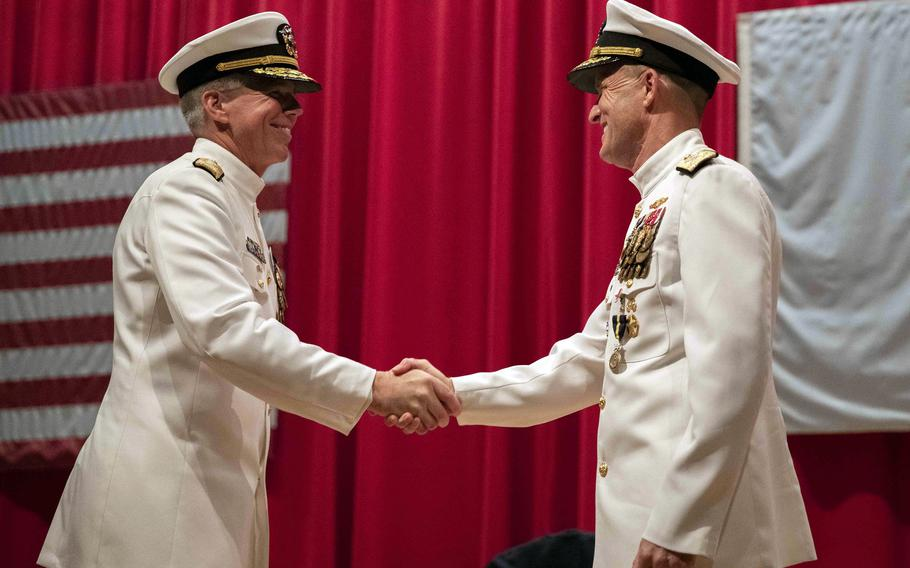 Vice Adm. Karl Thomas, left, greets Vice Adm. Bill Merz during a change-of-command ceremony for 7th Fleet at Yokosuka Naval Base, Japan, Thursday, July 8, 2021.