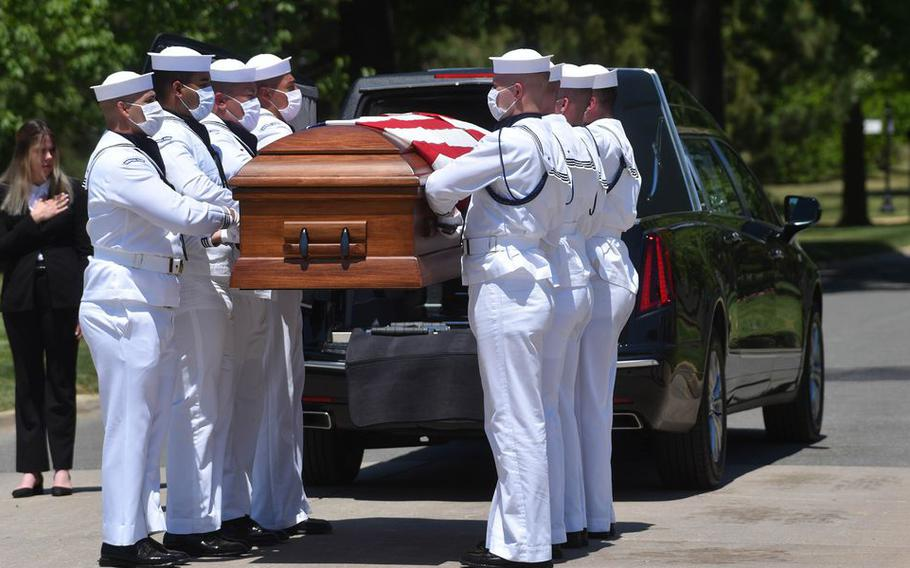 A photo from the burial service of Navy Radioman 3rd Class Thomas E. Griffith, 20, of Dayton, who was killed during World War II, at Arlington National Cemetery.