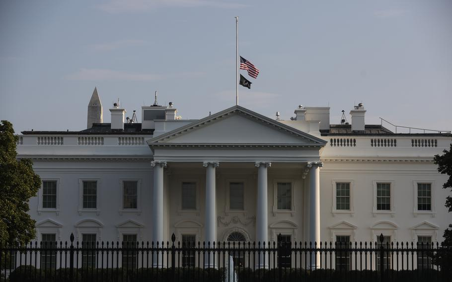 The U.S. flag on Saturday flies at half-staff over the White House after the deadly attack at Hamid Karzai International Airport.