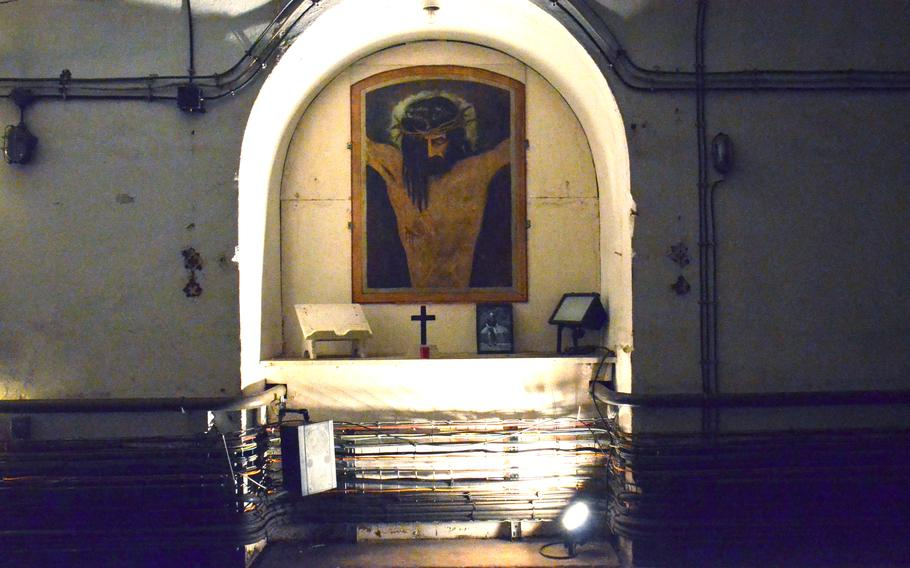 A depiction of Jesus Christ sits in a small alcove in one of the tunnels in Simserhof, a WWII fortification that was part of the Maginot Line in eastern France.