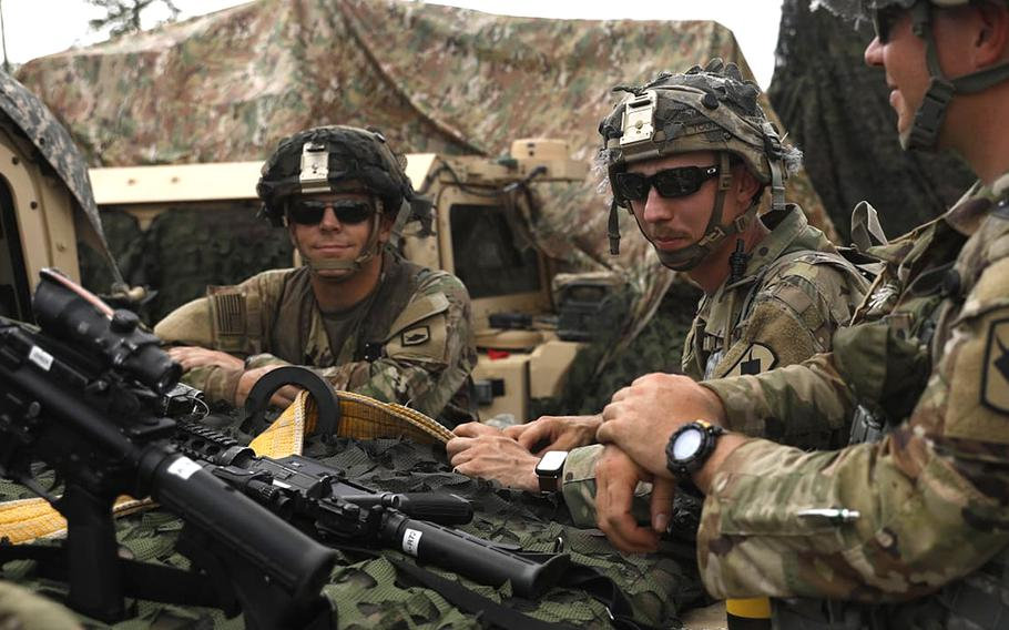 Spc. Jaden Clark, left, of the Nebraska Army National Guard's 1-134th Cavalry Squadron stands with fellow Guardsmen at Fort Polk, La., in July 2021. Clark was named full-time rodeo coach at the Nebraska College of Technical Agriculture, where he is also an agricultural instructor.
