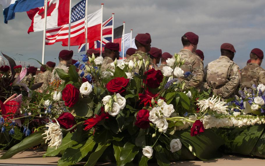 Members of the 82nd Airborne Division stand in front of a wreath during a ceremony on Sept. 20, 2021, in Nijmegen, Netherlands, to remember the 48 U.S. soldiers who died crossing the Waal River 77 years ago during Operation Market Garden in World War II.