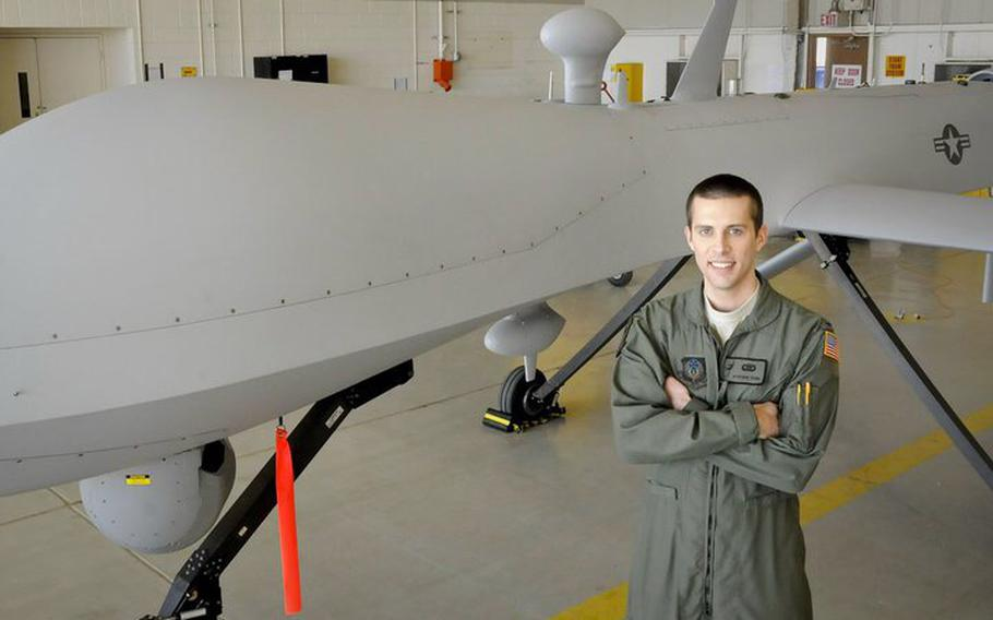Capt. Jon Young stands in front of a Predator drone at Cannon Air Force Base, N.M., in 2009. Young served as an intelligence officer and senior mission intelligence coordinator in the 3d Special Operations Squadron. He was inspired to join the military after the 9/11 terrorist attacks.