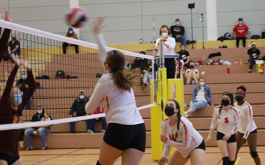 Kaiserslautern's Isabella Ross, left, slams a ball during a volleyball match against Vilseck High School at Vilseck, Germany, Saturday, Oct. 9, 2021.