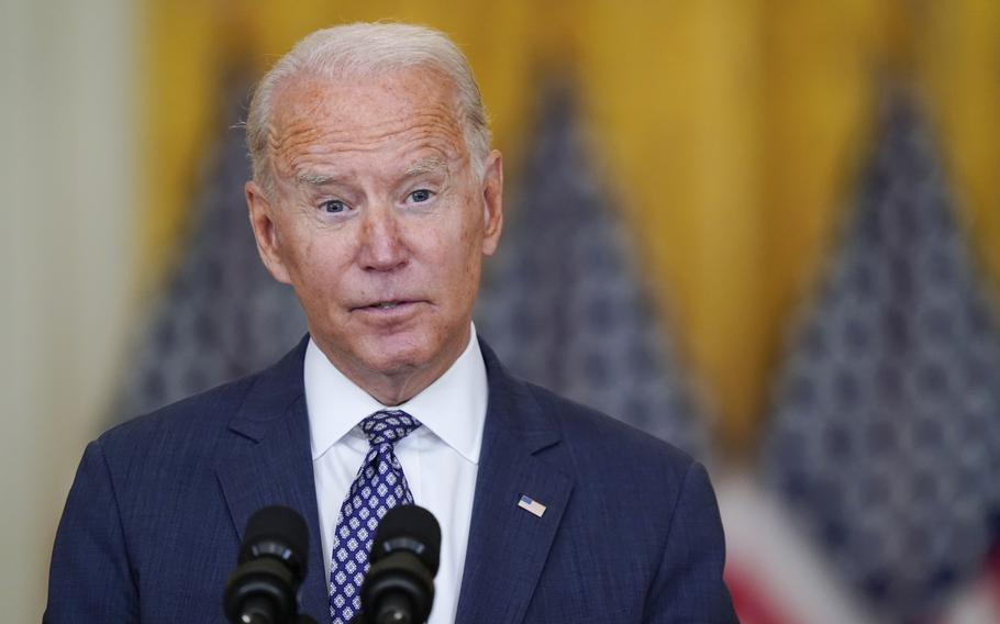 President Joe Biden answers questions from members of the media as he speaks about the evacuation of American citizens, their families, SIV applicants and vulnerable Afghans in the East Room of the White House, Friday, Aug. 20, 2021, in Washington.