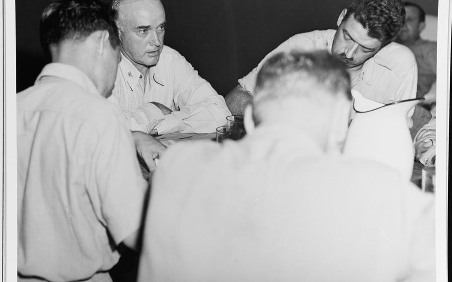 USS Indianapolis commanding officer Capt. Charles B. McVay III tells war correspondents on Guam about the sinking of his ship.