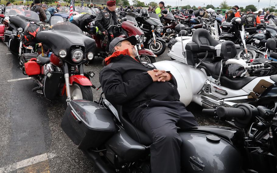 A rider takes a nap in the RFK Stadium staging area while awaiting the start of the Rolling to Remember ride, May 30, 2021 in Washington, D.C..