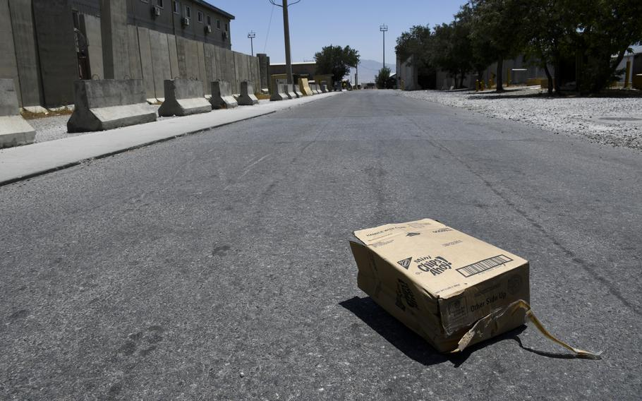 A box lies in the street at Bagram Airfield, Afghanistan, July 7, 2021, after U.S. troops transferred control of the base to Afghan security forces.