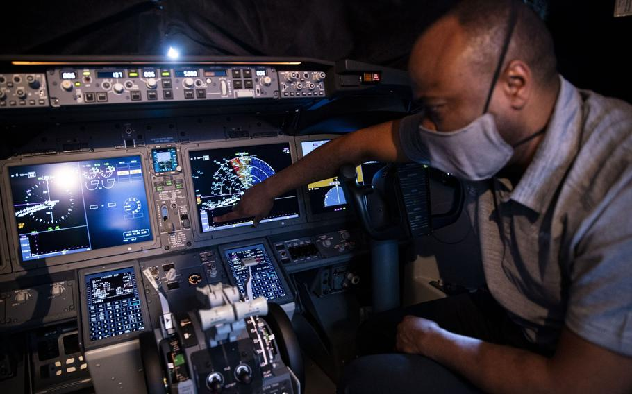 A Boeing employee demonstrates a touch screen control display in the cockpit of a Boeing Co. 737-9 aircraft at Ronald Reagan National Airport in Arlington, Va., on July 28, 2021.