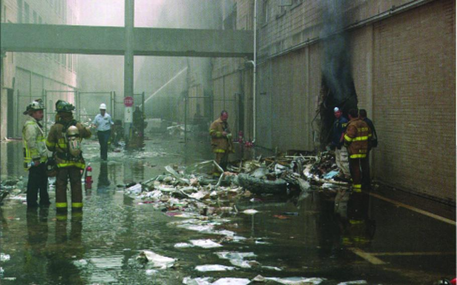 Retired Army Col. Marilyn Wills was working at the Pentagon on Sept. 11, 2001, when a highjacked airplane crashed into the building. She and others escaped by forcing out a second-floor window above the damaged wall shown here.