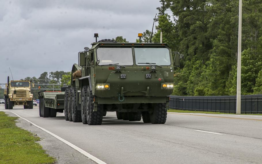 U.S. Marines drive onto Camp Lejeune, N.C., June 3, 2021. Marines with 2nd Transportation Battalion, Combat Logistics Regiment 2, 2nd Marine Logistics Group conducted a convoy across the U.S., one of the longest convoys in recent Marine Corps history.