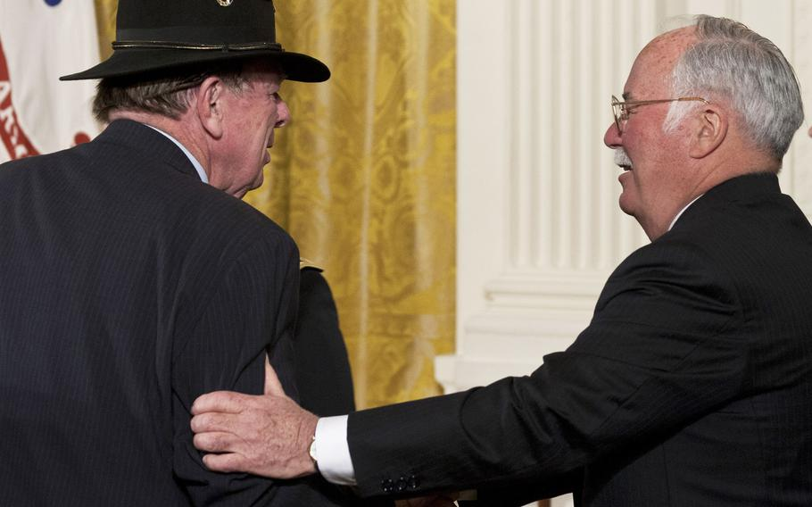 """Joe Galloway is greeted by Medal of Honor recipient Harvey """"Barney"""" Barnum before a ceremony at the White House in 2007."""