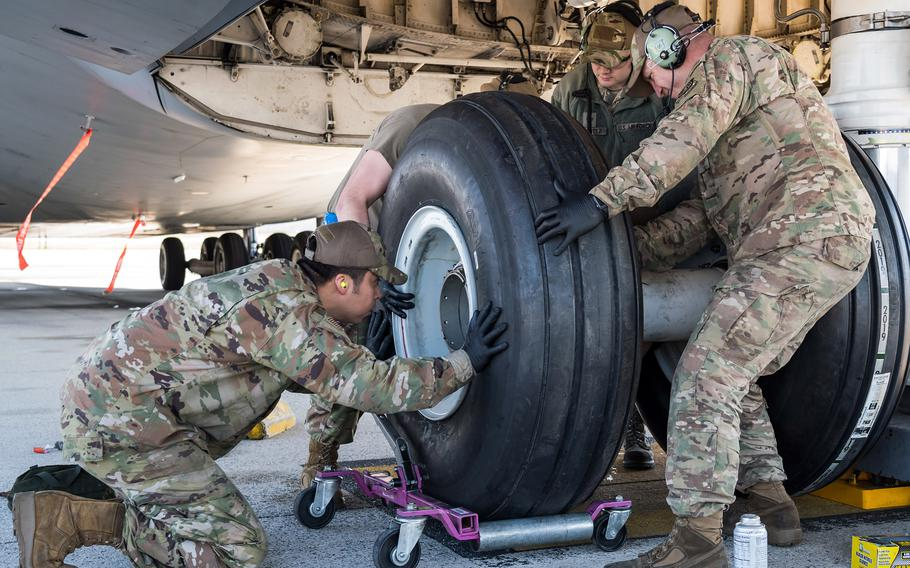 Airmen from the 436th Aircraft Maintenance Squadron work on a C-5M Super Galaxy in March 2020, at Dover Air Force Base, Del., wearing approved Operational Camouflage Pattern (OCP) bump caps. The Air Force on June 14, 2021, authorized airmen to wear camouflage tactical caps but said none are in stock at Army & Air Force Exchange Service outlets.