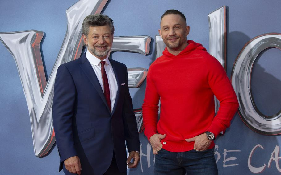 """Actor Tom Hardy, right, and director Andy Serkis appear during a photo call for their film """"Venom: Let There Be Carnage"""" at a screening in central London on Tuesday, Sept. 14, 2021."""