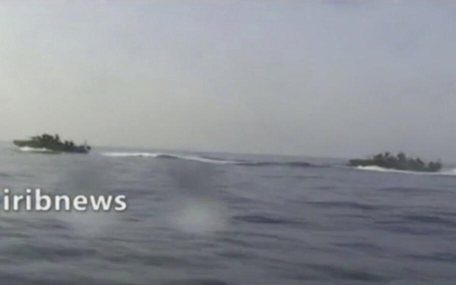 This frame grab from video aired by Islamic Republic of Iran Broadcasting, IRIB, state-run TV, on Thursday, Oct. 7, 2021, shows two vessels in the Persian Gulf. Iran's state TV reported that speedboats belonging to the country's paramilitary Revolutionary Guard have intercepted a U.S. vessel in the Persian Gulf. A U.S. Navy spokesman said he was not aware of any such encounter at sea over the past days.